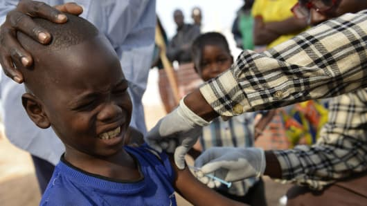 A child receives a vaccine in a makeshift field clinic of the Doctors Without Borders (MSF) organisation during a vaccination program against measles in Bangui, Central African Republic.