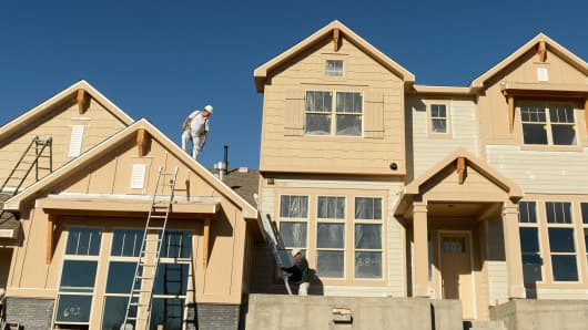 Construction crews work on new town homes in Erie, Colorado.
