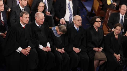 U.S. Supreme Court Chief Justice John Roberts, with Justices, Anthony Kennedy, Ruth Bader Ginsburg, Stephen Breyer, Sonia Sotomayor and Elena Kagan listen as U.S. President Barack Obama delivers his State of the Union speech.