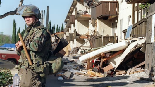 A National Guard soldier stands on a street after an earthquake in Northridge, Calif., Jan. 18, 1994.