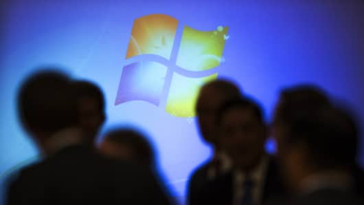 The Microsoft logo appears on screen prior a meeting in Beijing, Dec. 3, 2014.