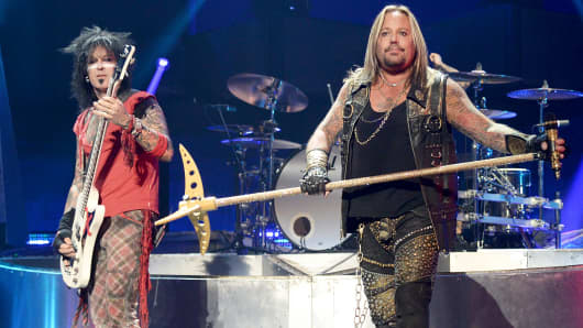 Nikki Sixx, left, and Vince Neil of the band Motley Crue perform onstage during the 2014 iHeartRadio Music Festival, Sept. 19, 2014, in Las Vegas.