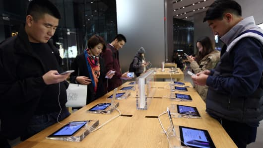 Customers at an Apple store in the China Central Mall in Beijing, China