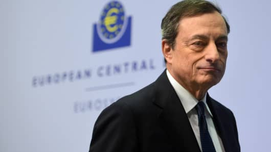 European Central Bank President Mario Draghi arrives for a press conference following the monthly ECB board meeting in the new ECB headquarters in Frankfurt am Main, Germany, Dec. 4, 2014.