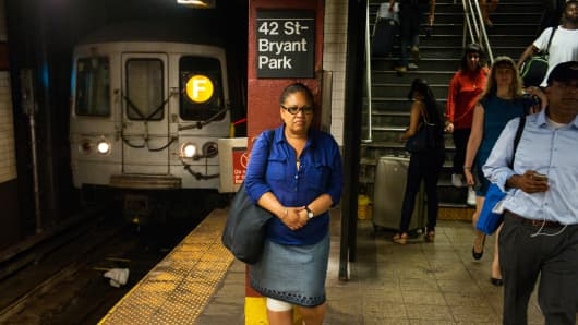 A woman waits for a subway train in New York City.