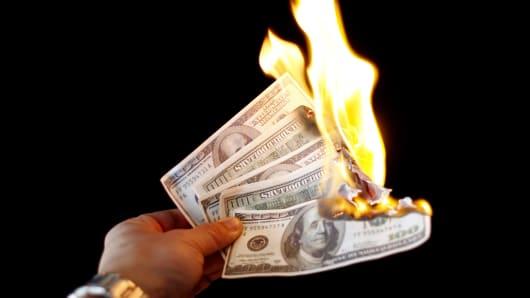 Hundred dollar bils on fire