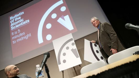 Richard Somerville, right, research professor at Scripps Institution of Oceanography, unveils an updated version of the Doomsday Clock during a press conference in Washington, Jan. 22, 2015.