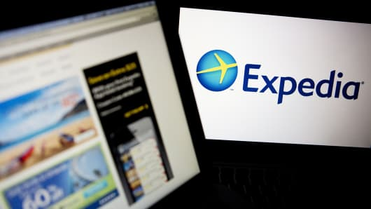 The Expedia homepage and logo are displayed on laptop computers.