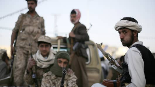 Houthi rebel fighters patrol a road in Sanaa January 23, 2015.