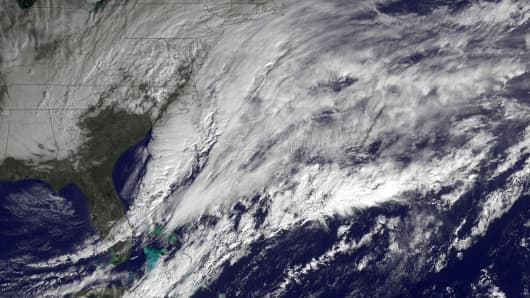 In this handout provided by the National Oceanic and Atmospheric Administration (NOAA) from the GOES-East satellite, a major winter storm develops over the mid-Atlantic region and is bringing snow to the Northeast of the U.S. pictured at 14:15 UTC on January 26, 2015.