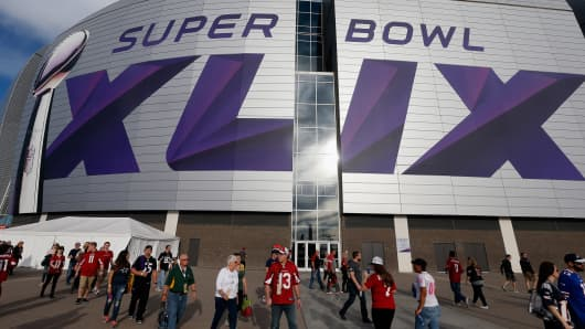 Fans walk outside University of Phoenix Stadium on January 25, 2015 in Glendale, Arizona.