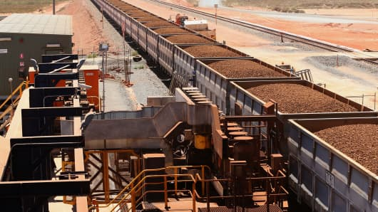 Rail cars laden with iron ore arrive at the receiving facility at Fortescue Metals' Herb Elliott Port in Western Australia.