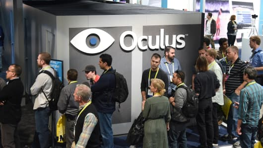 Attendees wait in line to get into the Oculus stand, January 6, 2015 at the Consumer Electronics Show in Las Vegas, Nevada.