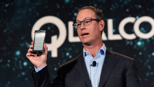 Qualcomm President Derek Aberle displays a LG G Flex 2 smartphone that contains Qualcomm's Snapdragon 810 chip.