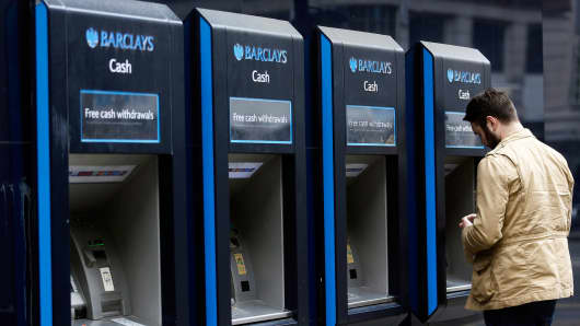 A file photo of a Barclays ATM machines in London last May.