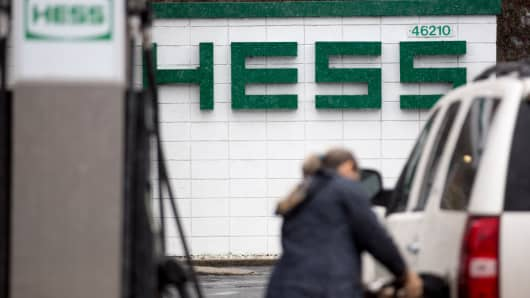 A customer refuels at a Hess gas station in Falls Church, Virginia, Jan. 26, 2015.