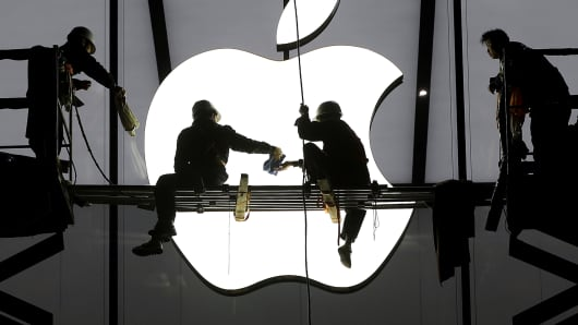 Workers prepare for the opening of an Apple store in China.