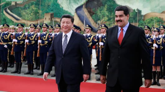 Venezuela's President Nicolas Maduro, right, walks with Chinese President Xi Jinping as they arrive to a welcoming ceremony at the Great Hall of the People on January 7, 2015 in Beijing, China.