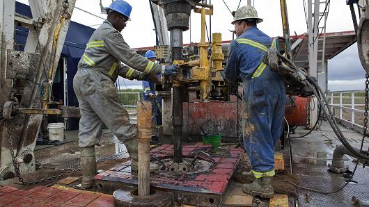 Oil rig workers production crude oil exploration