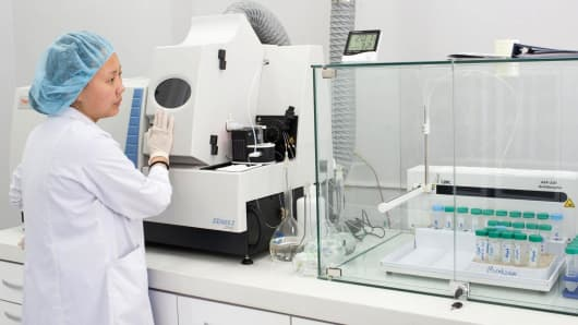 An employee uses a Thermo Fisher Scientific Inc. X Series 2 inductively coupled plasma mass spectrometry machine to analyze copper concentrate samples inside the Central Geological Laboratory in Ulaanbaatar, Mongolia.
