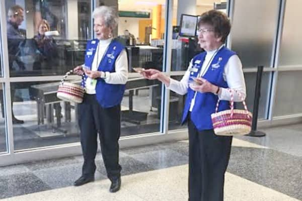 Volunteers hand out complimentary cookies at Fort Wayne International Airport