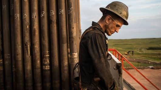 A floorhand works on an oil rig in the Bakken shale formation outside Watford City, North Dakota.