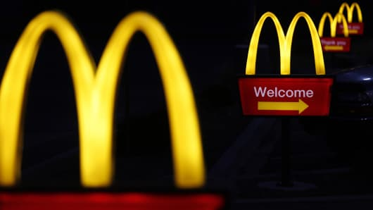Illuminated golden arches mark the entrance to a McDonald's restaurant in Shelbyville, Ky., Jan. 23, 2015.