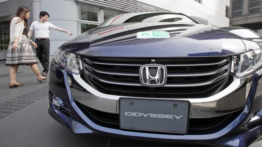 A Honda Odyssey is displayed outside the company's headquarters in Tokyo.