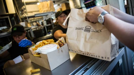 Customers pick up their orders from Shake Shack on in Madison Square Park in New York City.