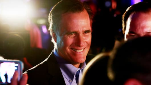 Mitt Romney is greeted by fellow Republicans at a dinner during the Republican National Committee's annual winter meeting aboard the USS Midway on Jan. 16, 2015 in San Diego.