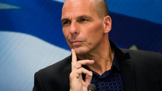 Newly appointed Greek Finance Minister Yanis Varoufakis attends a hand over ceremony in Athens, January 28, 2015.