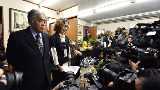 Junko Ishido, mother of Kenji Goto, speaks to reporters while her husband Yukio Ishido stands beside her at their home in Tokyo on February 1.