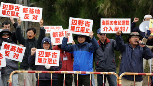 People gather in front of the US Marines Camp Schwab in Okinawa to protest on February 01