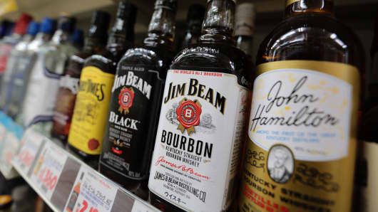 Bottles of Beam Inc.'s Jim Beam bourbon whiskey, center, are displayed for sale at a liquor store.