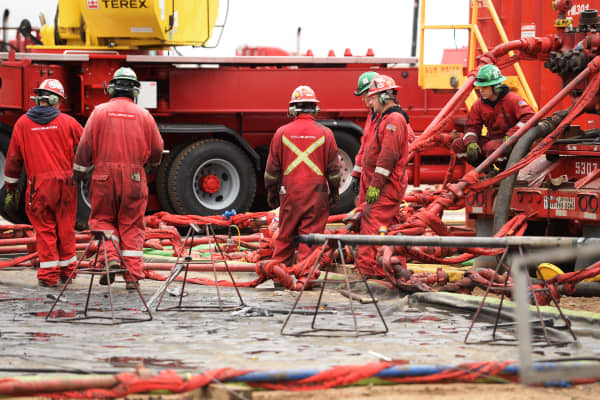 Crews work at Anadarko's centralized fracking facility and drill site near Fort Lupton, Colorado.