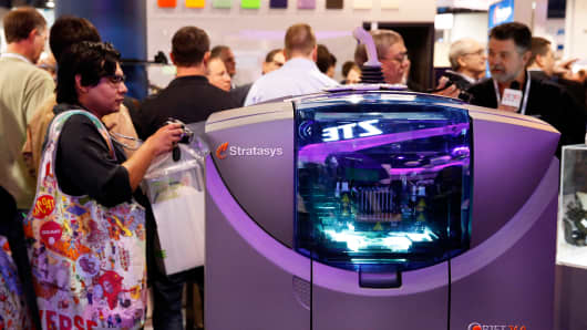 An attendee photographs a Stratasys Ltd. 3D printer during a CES show.