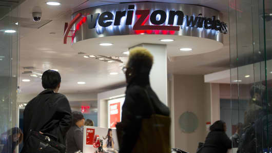 A customer walks into a Verizon Wireless retail store in Washington, D.C.
