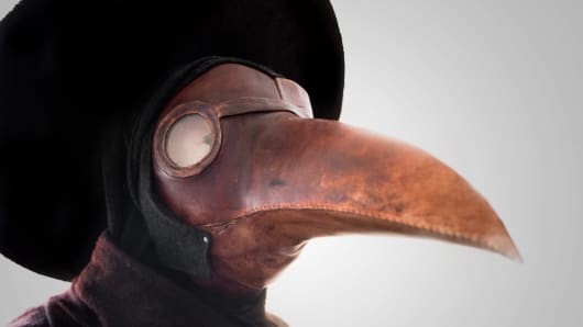 A primitive gas mask in the shape of a bird's beak. A common belief at the time was that the plague was spread by birds. It was thought that by dressing in a bird-like mask, the wearer could draw the plague away from the patient and onto the garment the plague doctor wore.
