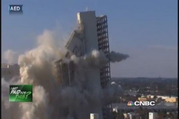 We get paid to implode buildings