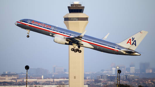 An American Airlines aircraft takes off form a runway at Dallas-Fort Worth International Airport, Jan. 15, 2015, in Grapevine, Texas.