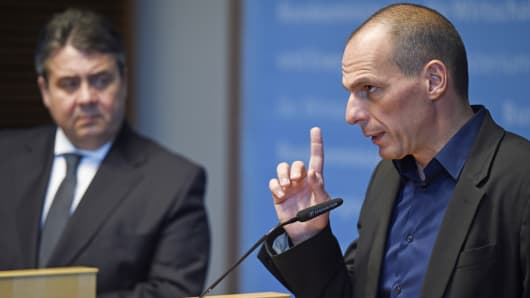 Greek Finance Minister Yanis Varoufakis, right, speaks as German Economy Minister Sigmar Gabriel looks on during a press conference after a meeting in Berlin, Feb. 5, 2015.