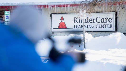 Television crews report from outside the KinderCare Learning Center on February 5, 2015 in Palatine, Illinois.