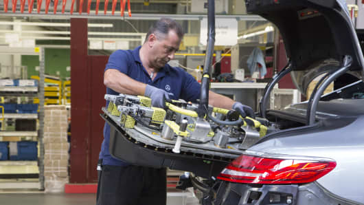 An employee works on a Mercedes-Benz S-Class Coupe, in Stuttgart, Germany.