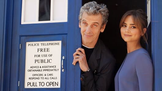 "Peter Capaldi, the 12th Doctor, poses with his on-screen companion Jenna Coleman during a world tour to promote the new season of ""Doctor Who"" in Sydney."