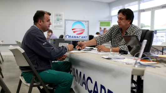 A customer for heath insurance under the Affordable Care Act sits with an advisor with UniVista Insurance in Miami.