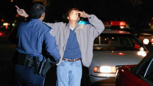 Police officer administering sobriety test
