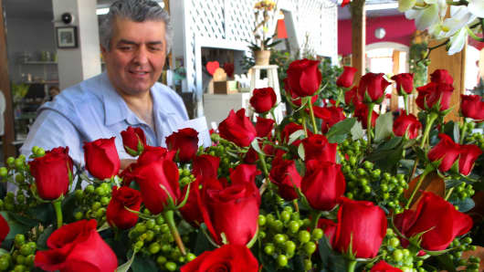 File photo: Yianni Tsaousisis checks on red rose arrangements in his south Boston store.