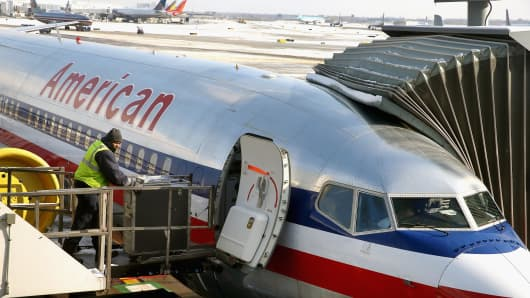 An American Airlines jet is prepared for a flight at O'Hare Airport.