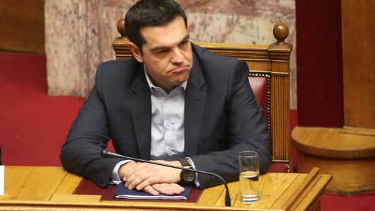 Greek Prime Minister Alexis Tsipras addresses to the parliament members during government's policy statement in Athens, on February 8, 2015.
