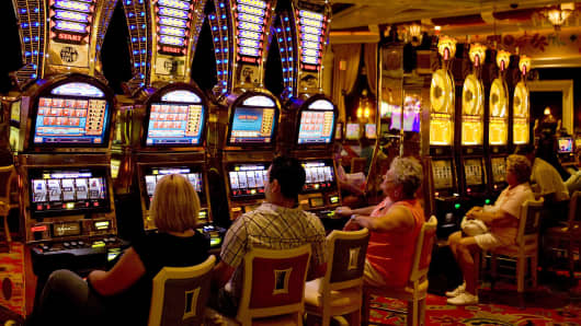 People sitting at a bank of slot machines at the Wуnn Hotel and Casino is seen in this 2009 Las Vegas, Nevada.